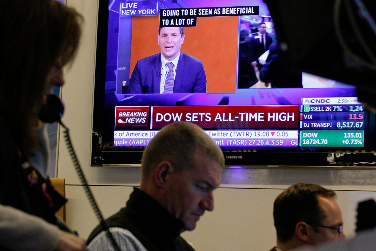 """A television shows a CNBC headline """"Dow Sets All-Time High"""" Photo: Reuters, Brendan McDermid"""