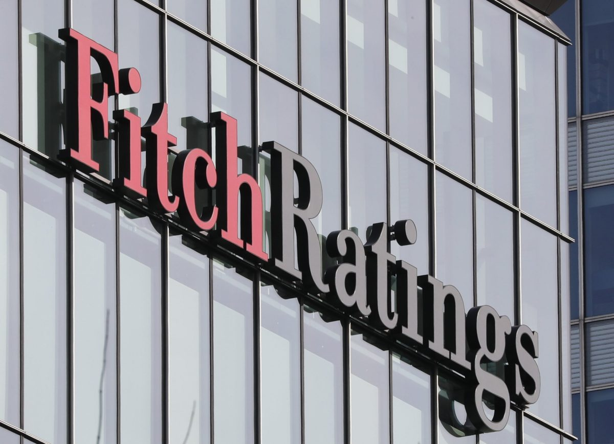 The Fitch Ratings logo is seen at their offices at Canary Wharf financial district in London,Britain. Photo: Reuters, Reinhard Krause