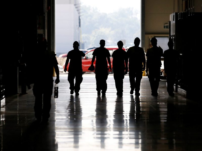 Workers walk  at the newly opened Volkswagen Crafter factory. Photo: Reuters, Kacper Pempel