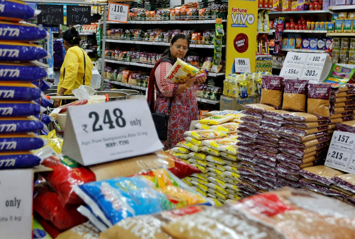 A woman looks at an item as she shops at a food superstore in Ahmedabad, India October 13, 2016. Photo: Reuters, Amit Dave