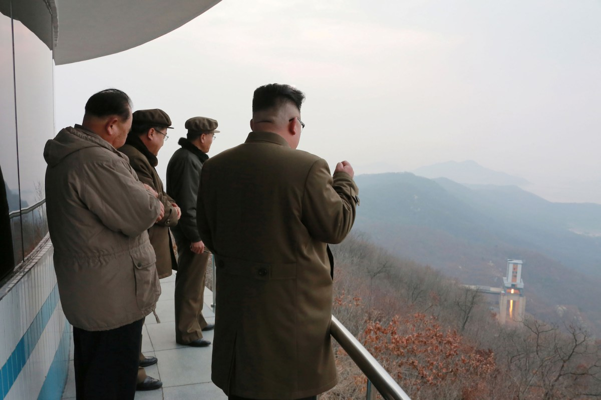 North Korean leader Kim Jong-un watches a ground test of a high-thrust engine for his country's missile program. Photo: KCNA via Reuters