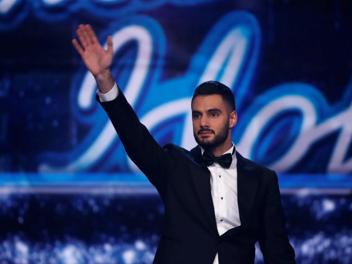 "Palestinian singer Yaqoub Shaheen, after winning TV show, Arab Idol, performed a patriotic song while wearing the Palestinian flag on his shoulders, singing the line: ""My pledge and my oath, my blood is Palestinian"". Photo: REUTERS"