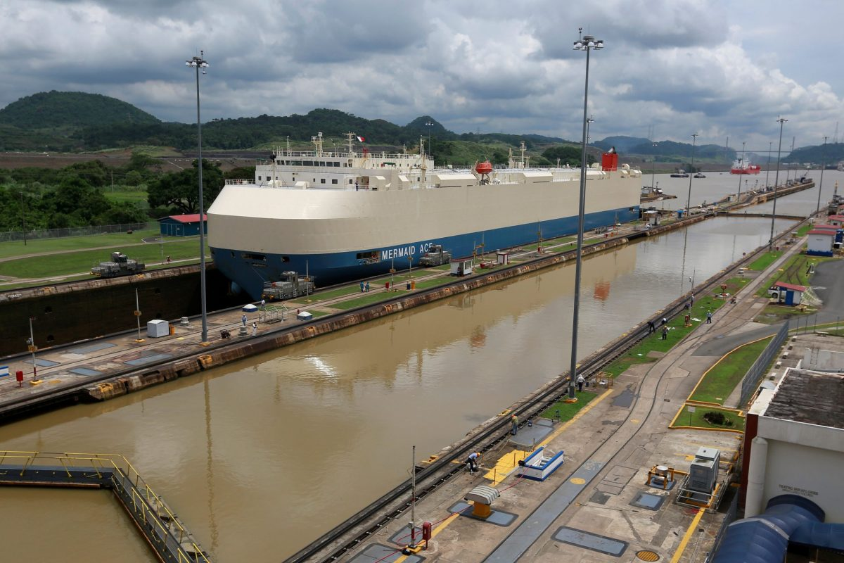 A cargo ship is pictured crossing through the Miraflores locks, a day before the inauguration of the Panama Canal Expansion projectt. Photo: Reuters, Alberto Solis