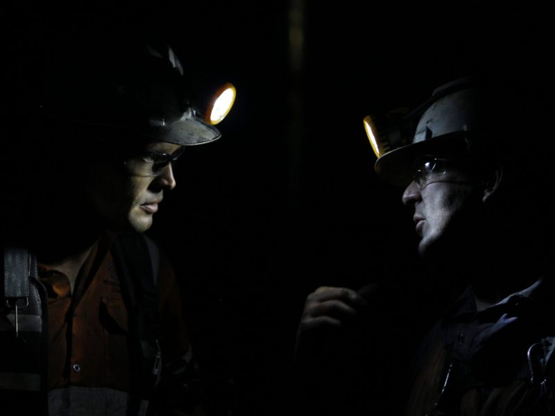 Two coal miners talk to each other in a chamber of the Metropolitan coal mine at Helensburgh, 40km (25 miles) south west of Sydney. Photo: Reuters / Tim Wimborne
