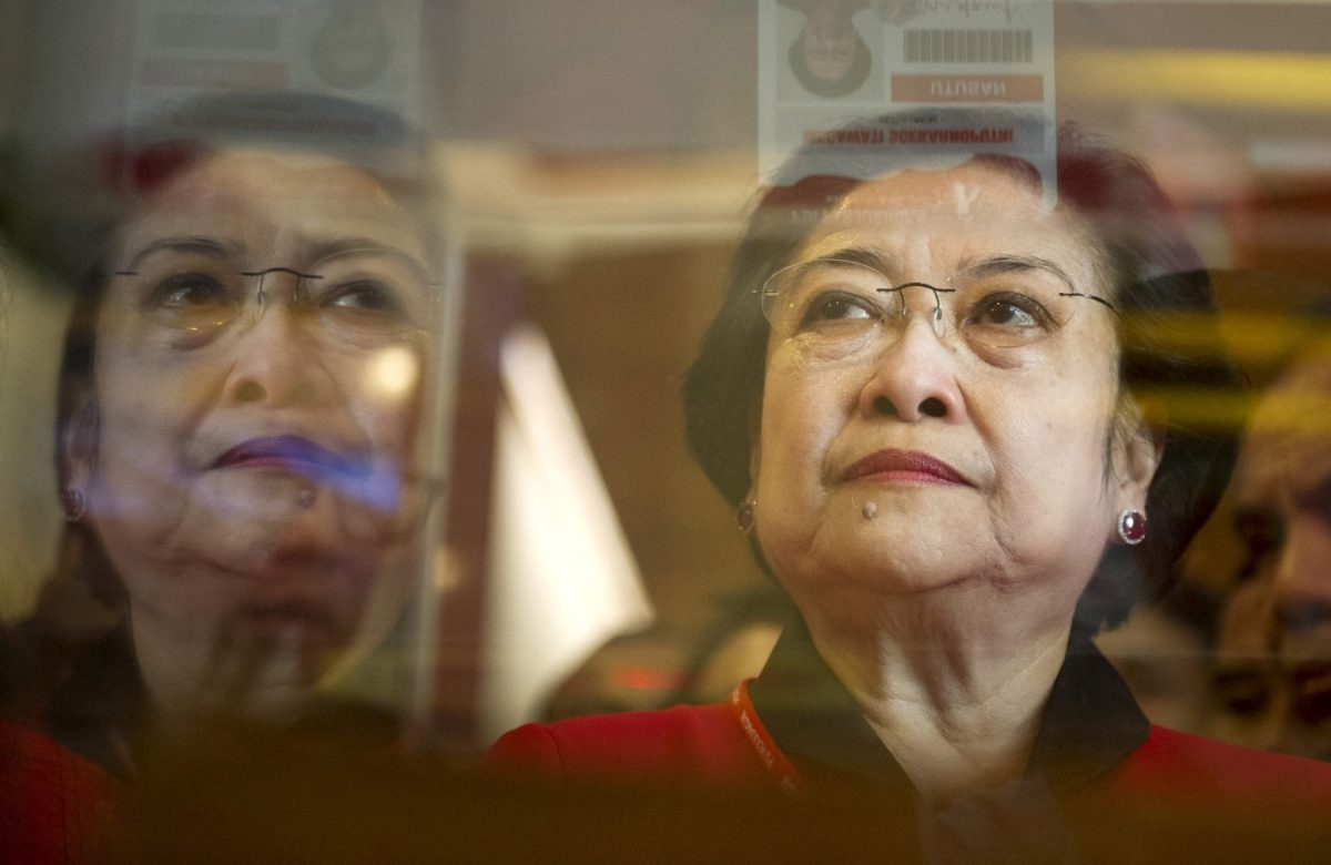 The leader of the Indonesia Democratic Party of Struggle (PDIP) Megawati Sukarnoputri looks at a booth displaying memorabilia on the sidelines of the 4th PDIP congress at the Inna Grand Bali Beach hotel on the resort island of Bali April 10, 2015 in this photo taken by Antara Foto. REUTERS/Antara Foto/Andika Wahyu ???ATTENTION EDITORS - THIS IMAGE HAS BEEN SUPPLIED BY A THIRD PARTY. IT IS DISTRIBUTED, EXACTLY AS RECEIVED BY REUTERS, AS A SERVICE TO CLIENTS. MANDATORY CREDIT. INDONESIA OUT. NO COMMERCIAL OR EDITORIAL SALES IN INDONESIA.? - RTR4WS5T