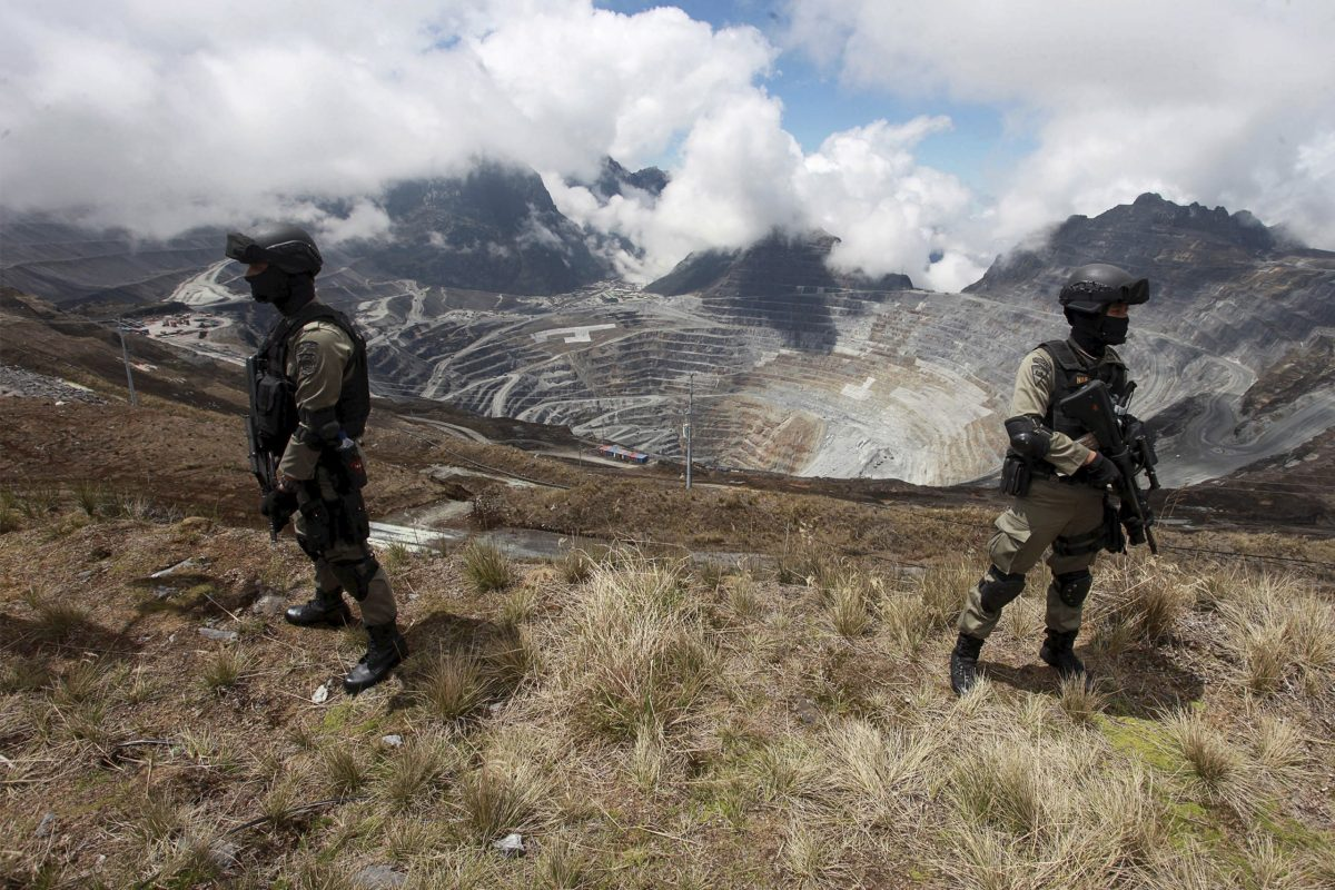 Indonesian police stand guard at the open-pit mine of PT Freeport's Grasberg copper and gold mine complex near Timika, in the eastern province of Papua, Indonesia. Photo: Antara Foto via Reuters /Muhammad Adimaja