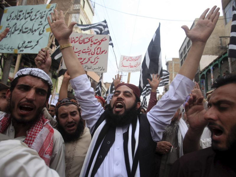 Supporters of the Jamiat Ulema-e-Islam religious party shout slogans as they protest the execution of Mumtaz Qadri –the man who assassinated Punjab governor Salman Taseer after he called for the pardoning of a Christian woman sentenced to death for allegedly insulting the Prophet Muhammad – in March 2016. Photo: Reuters