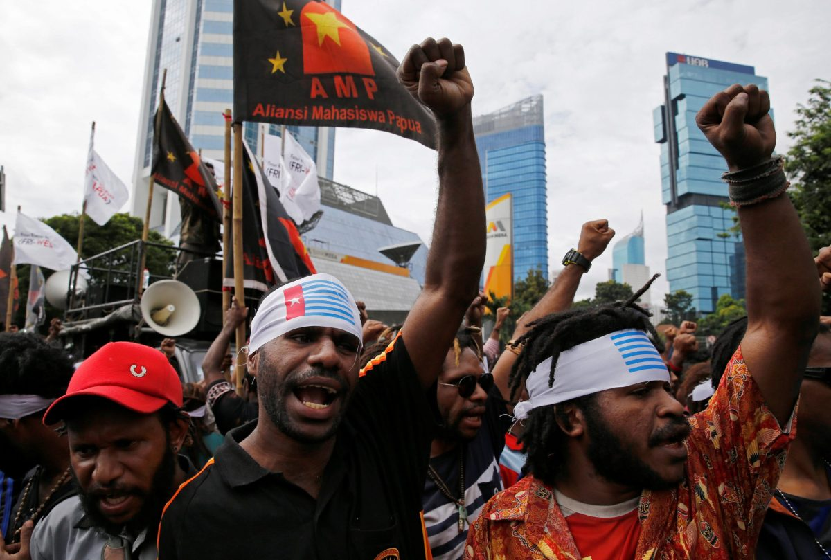 Papuan protesters shout slogans during a rally in December 2016 calling for their right to self-determination. Reuters/Beawiharta