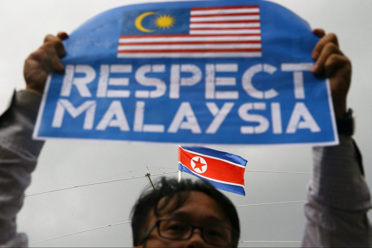 A member of the youth wing of the National Front, Malaysia's ruling coalition, holds a placard at a protest at the North Korea embassy, following the murder of Kim Jong-nam in Kuala Lumpur. Photo: Reuters/Athit Perawongmetha