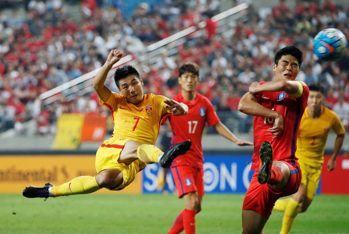 South Korea, in red, take on China, in Seoul, last September. Photo: Reuters