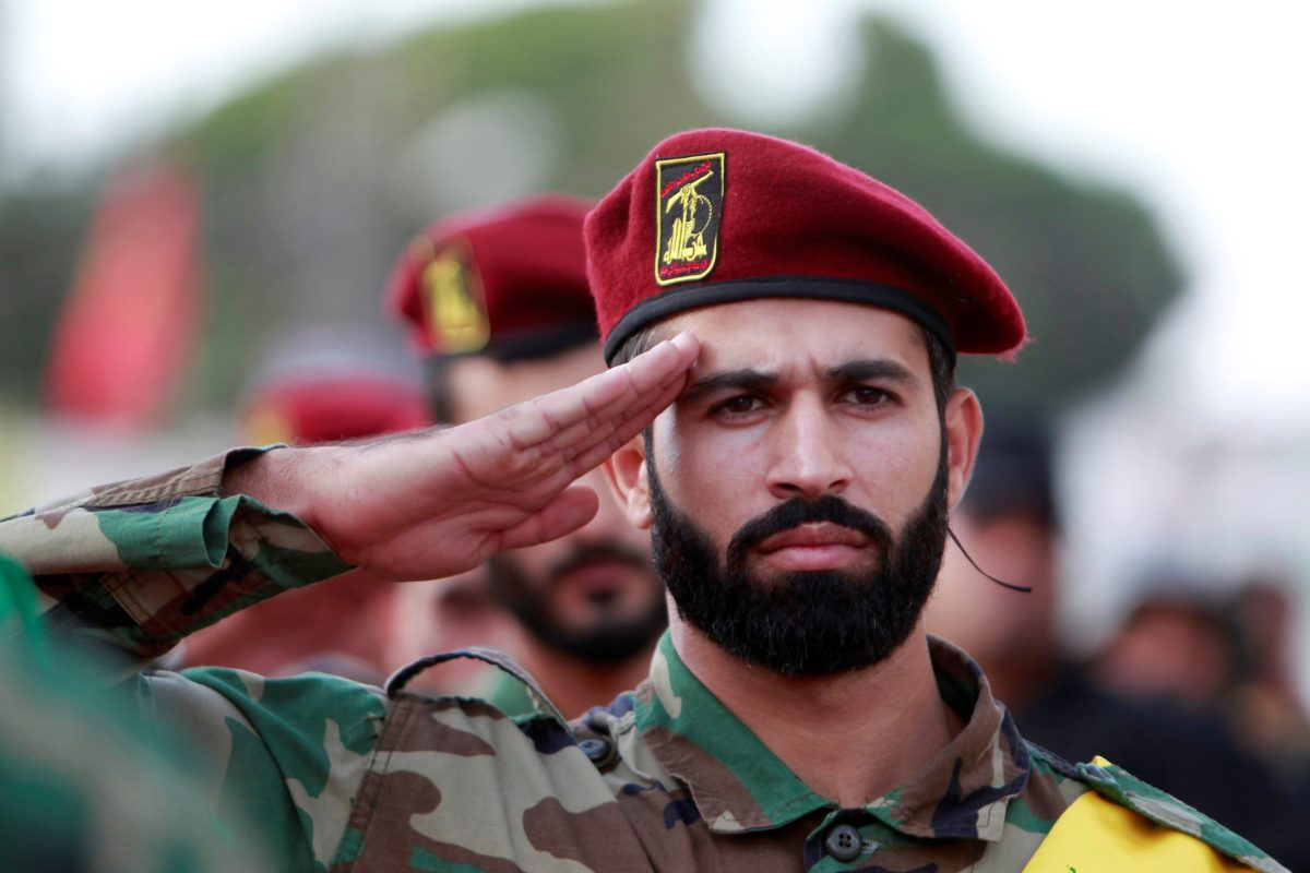 Hezbollah members salute during the funeral of fighter Mohamad al-Shami, who was killed during clashes in Syria's Aleppo. Photo: Reuters/Ali Hashisho