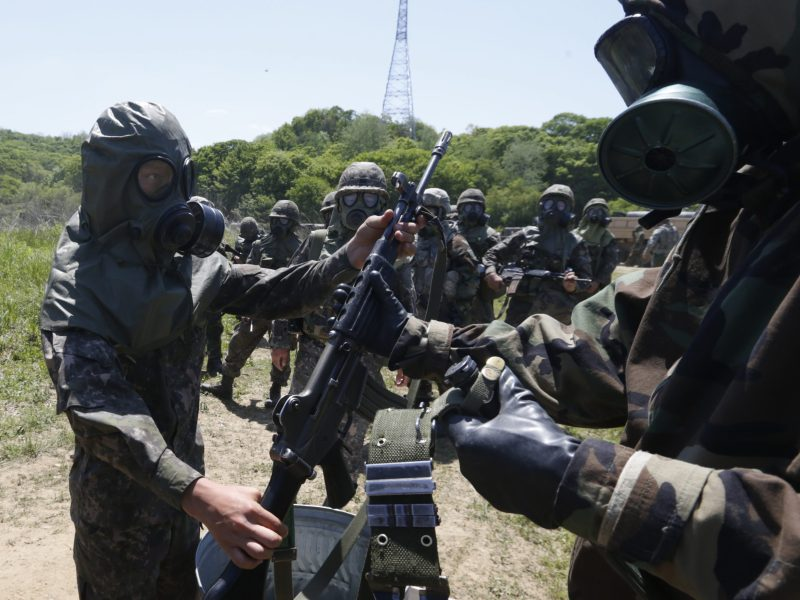 A U.S. soldier (R) checks South Korean soldiers during their decontamination training against possible chemical, biological, radiological and nuclear threats at Steel Zenith Field Training Exercise in Yeoncheon, about 65 km (40 miles) north of Seoul, May 16, 2013. U.S. Troops from the 1st Battalion, 38th Field Artillery Regiment and 23rd Chemical Battalion conducted the military drills on Thursday with South Korean soldiers at a training field near the demilitarised zone separating North Korea from the South. The two Koreas remain technically at war under a mere truce that ended hostilities in their 1950-53 conflict.  REUTERS/Lee Jae-Won (SOUTH KOREA - Tags: POLITICS MILITARY) - RTXZOKB