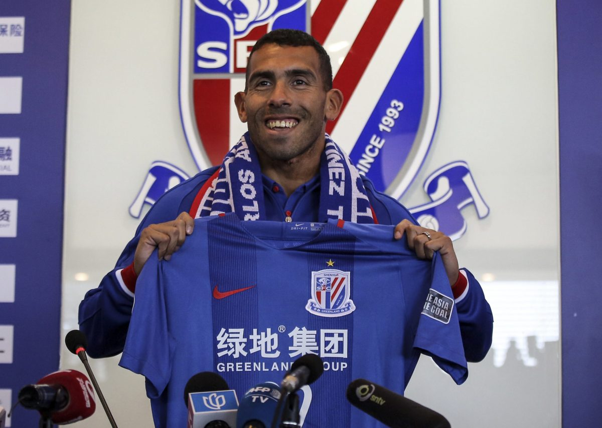 Argentine striker Carlos Tevez poses after signing for Shanghai Shenhua in December 2016, a move that reportedly made him the world's highest-paid football player. Photo: AGENCE FRANCE-PRESSE