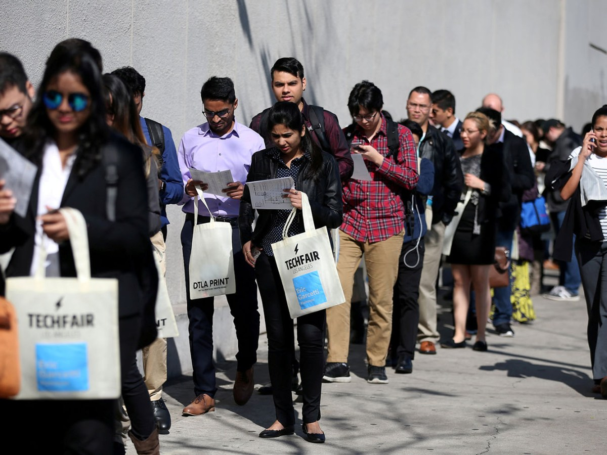 Job applicants wait in line at a technology job fair in Los Angeles. Photo: Reuters
