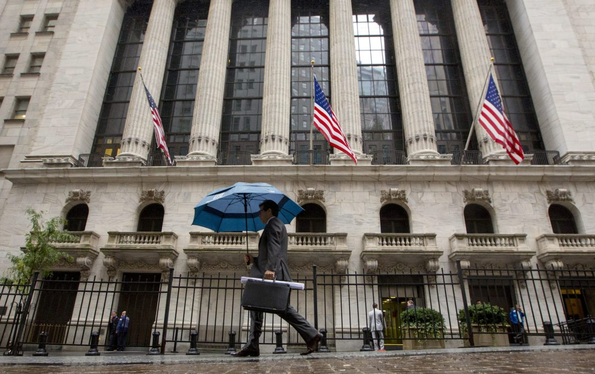A man passes the New York Stock Exchange. Photo: Reuters/Brendan McDermid