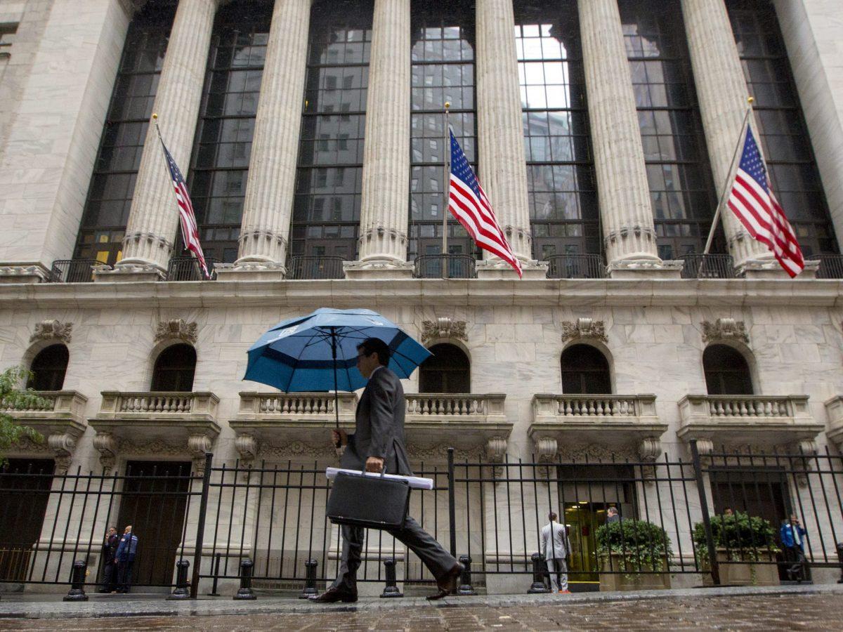 A man passes the New York Stock Exchange. Photo: Reuters/Brendan McDermid