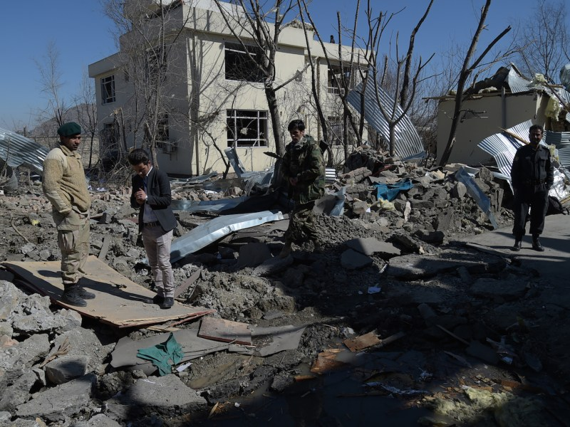 Afghan security personnel inspect the wreckage of the district police headquarters in Kabul a day after a suicide car bomb attack on March 1 killed 16 people in simultaneous Taliban suicide assaults. Photo: AFP / Shah Marai