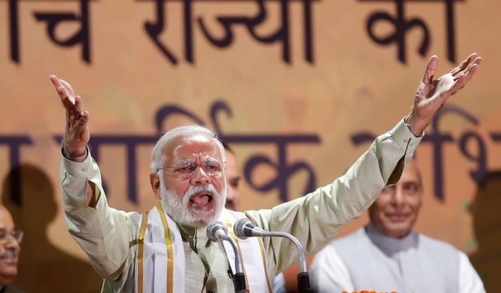 Indian PM Narendra Modi addresses supporters at BJP headquarters in New Delhi in March 2017.  Photo: Reuters/ Adnan Abidi
