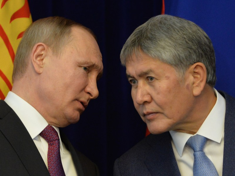 Russian President Vladimir Putin (L) chats with his Kyrgyz counterpart Almazbek Atambayev during a visit in late February to the Central Asia country. Putin promised to strengthen Kyrgyzstan's military to help combat Islamist threats. Photo: AFP/ Vyacheslav Oseledko