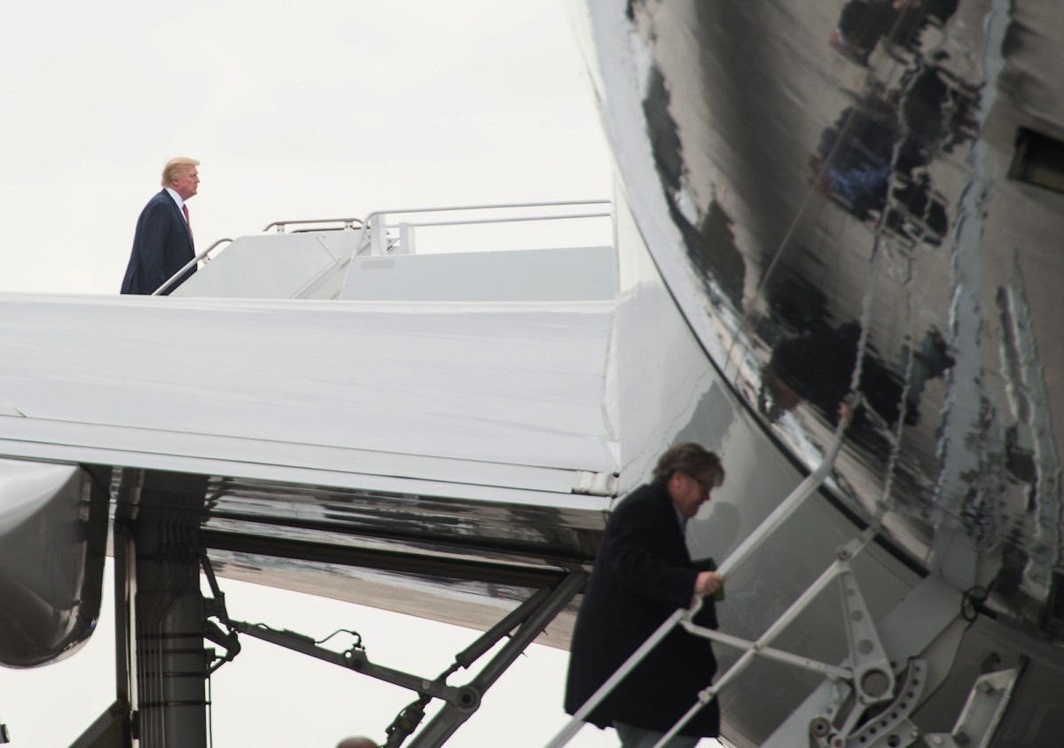 President Donald Trump and top strategist Steve Bannon board Air Force One at Palm Beach Airport in Florida. Photo: AFP/Nicholas Kamm