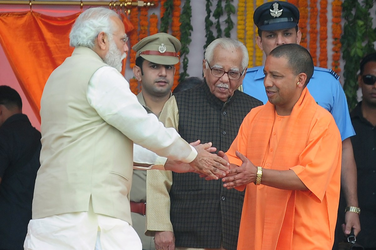 Indian Prime Minister Narendra Modi and Uttar Pradesh Chief Minister Ajay Singh Bisht. Photo: AFP/ Sanjay Kanojia