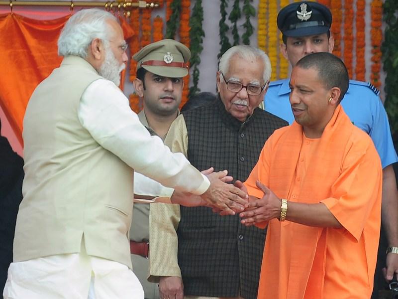 Indian Prime Minister Narendra Modi and Uttar Pradesh Chief Minister Ajay Singh Bisht. Photo: AFP/ Sanjay Kanojia