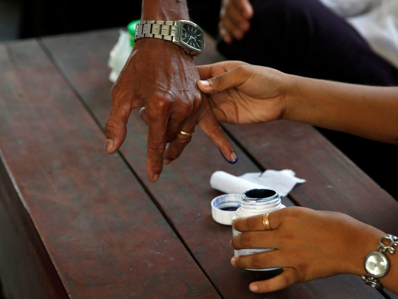 A man gets his finger inked as he casts his ballot during Myanmar by-elections on April 1, 2017.  Aung San Suu Kyi's party won nearly half of the contested seats.  Photo: Reuters