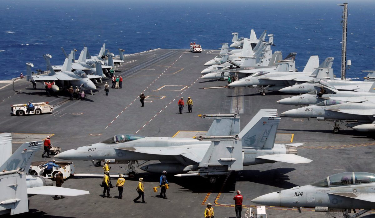 US Navy personnel prepare to launch an F18 fighter jet on the deck of USS Carl Vinson during an exercise in the South China Sea in March this year. Photo: Reuters