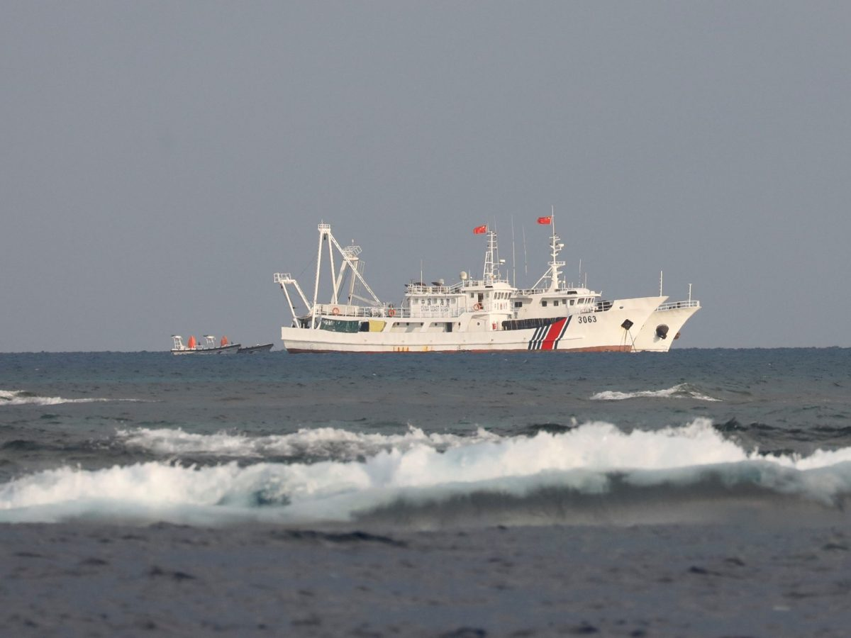 Chinese Coast Guard vessels at the disputed Scarborough Shoal. Photo: Reuters / Erik De Castro