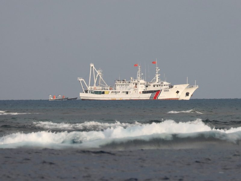 Chinese Coast Guard vessels at the disputed Scarborough Shoal. Photo: Reuters / Erik De Castro