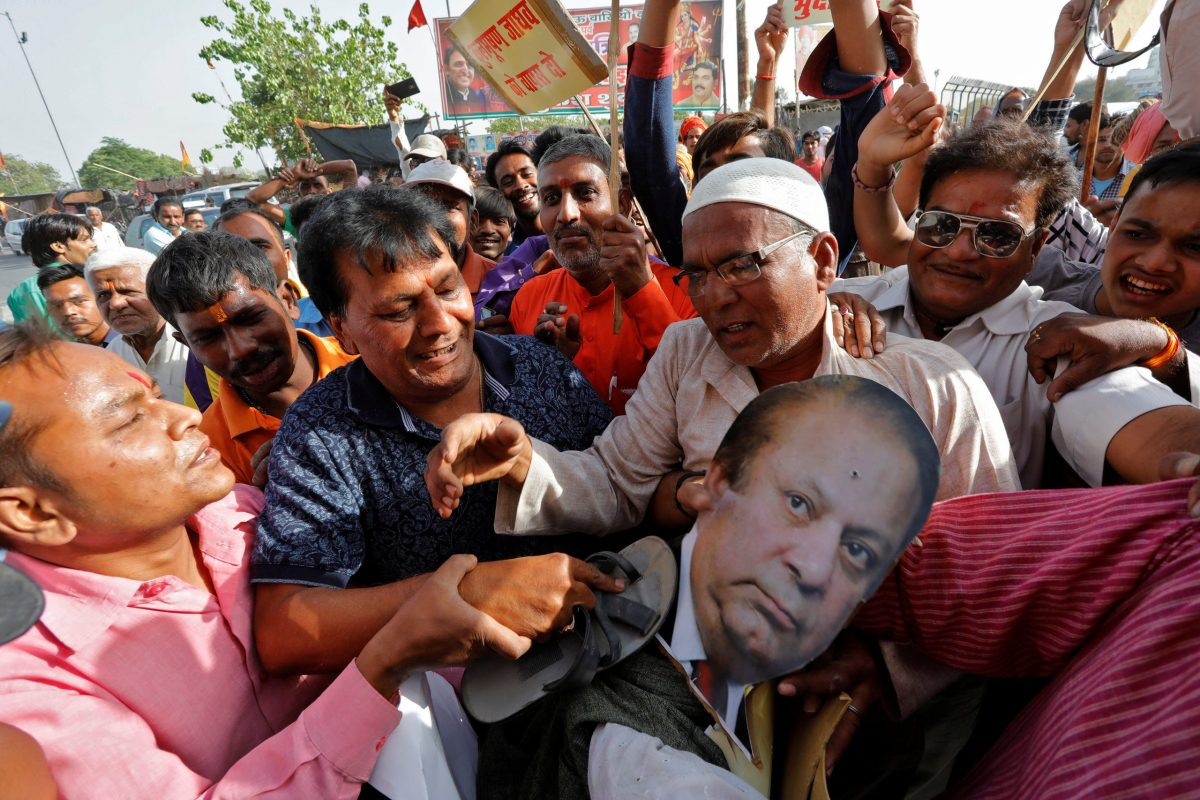 Indians beat an effigy of Pakistan's Prime Minister Nawaz Sharif during a protest in April against the death sentence given to former Indian naval officer Kulbhushan Jadhav in Pakistan. Photo: Reuters / Pawan Kumar