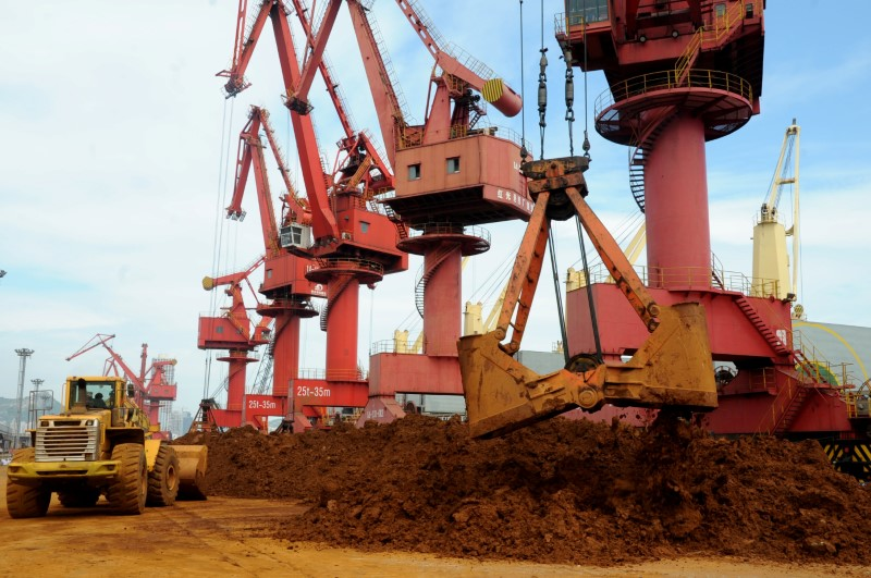 Iron ore being unloaded at a port in Jiangsu. Photo: Reuters