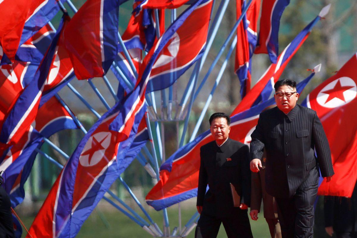 North Korean flags wave behind leader Kim Jong-un. Photo: Reuters