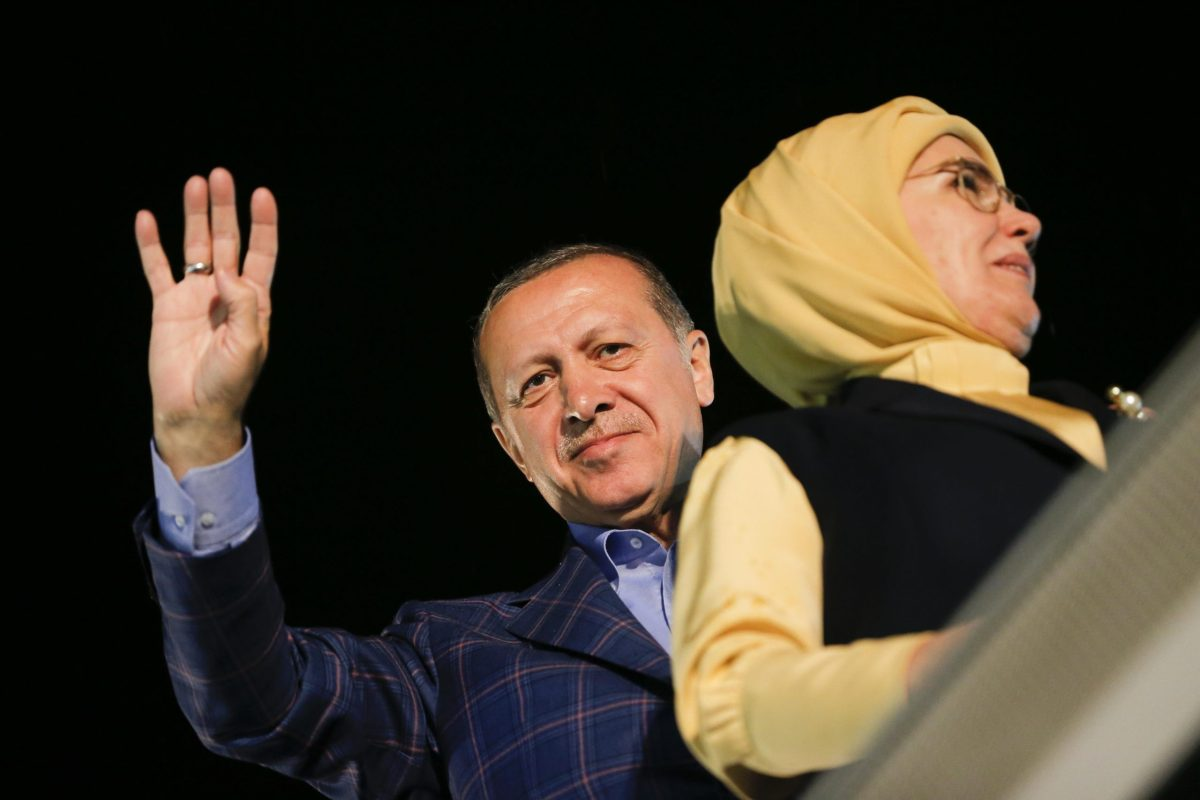President Tayyip Erdogan and his wife Emine greet supporters in Istanbul on Sunday. Photo: Reuters