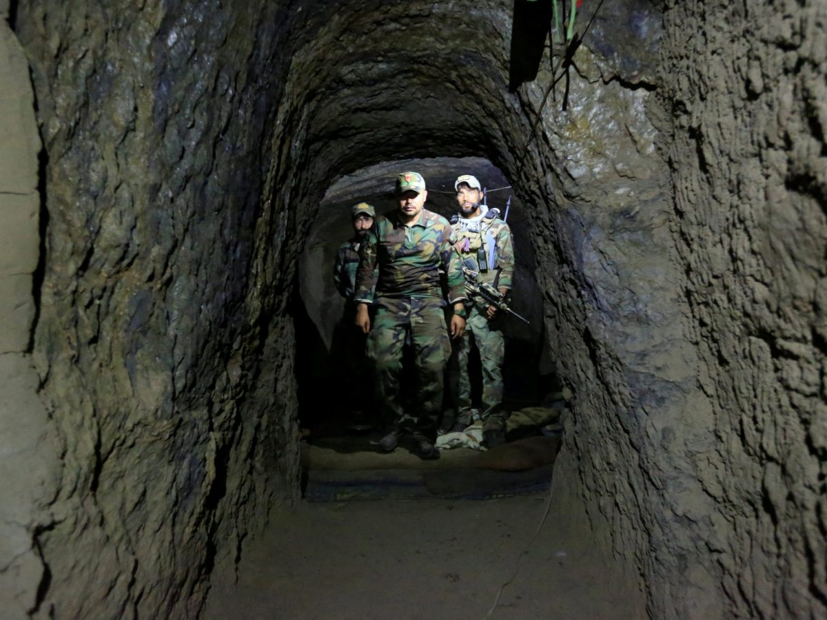 Afghan Special Forces inspect the inside of a cave which was used by suspected Islamic State militants at the site where an MOAB, or ''mother of all bombs'', struck the Achin district of the eastern province of Nangarhar, Afghanistan, on April 23, 2017. Photo: Reuters