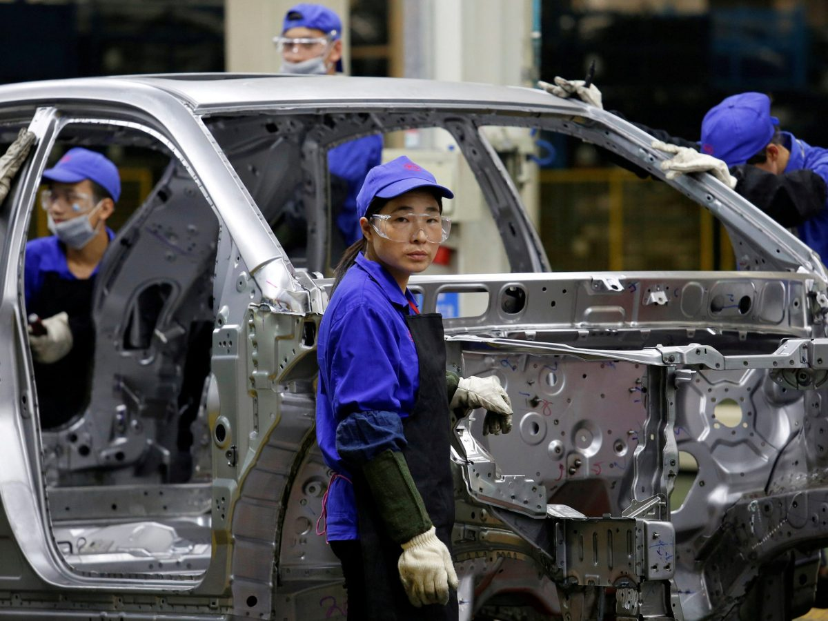 A worker looks on at a BYD assembly line in Shenzhen, China. Photo: Reuters/Bobby Yip
