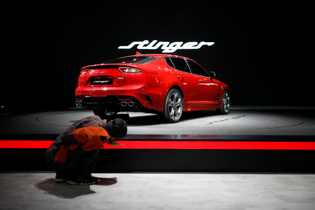 A man checks out a Kia Stinger sedan during the 2017 Seoul Motor Show in Goyang, South Korea. Photo: Reuters / Kim Hong-Ji