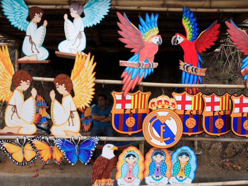 Painted wooden figures on sale in Cojutepeque, El Salvador. Art need not be a business, but can relieve stress. Photo: Reuters