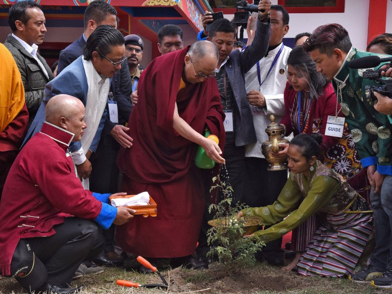 The Dalai Lama waters a plant during his visit to Tawang district in the northeastern state of Arunachal Pradesh, India, on April 9, 2017. Photo: Reuters/Anuwar Hazarika