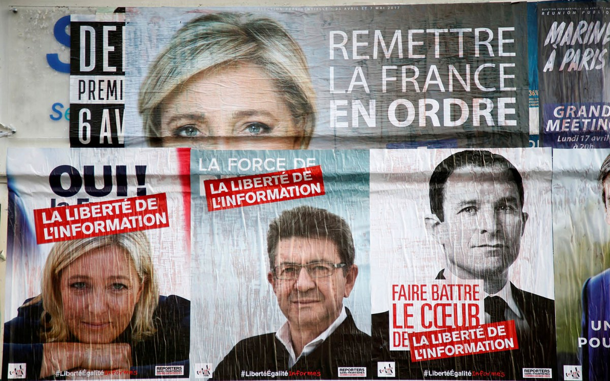 Campaign posters (left to right) for French election candidates Marine Le Pen, Jean-Luc Melenchon and Benoit Hamon. Photo: Reuters