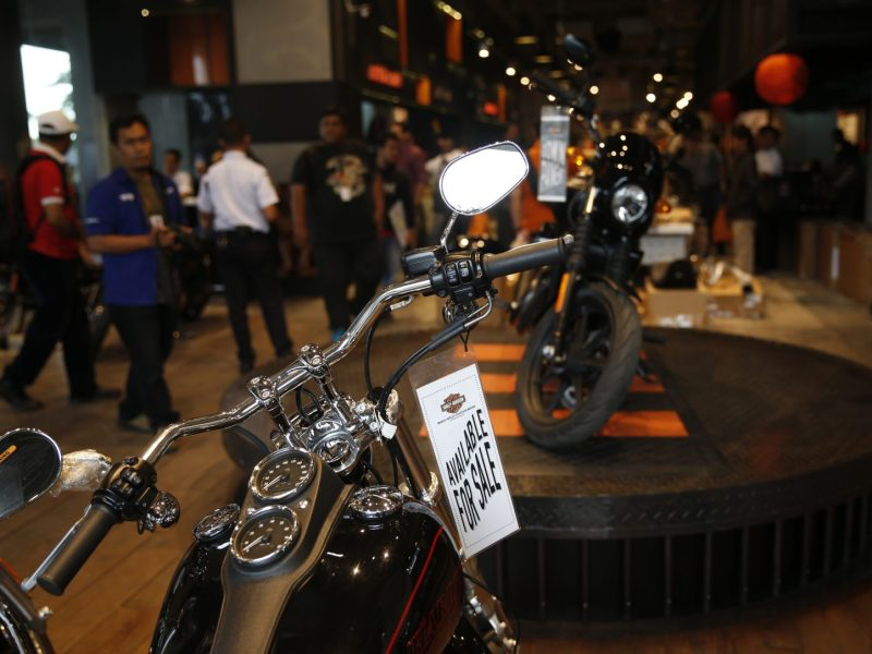 Customers inspect Harley-Davidson motorcycles displayed in Jakarta in February 2016. Photo: Reuters