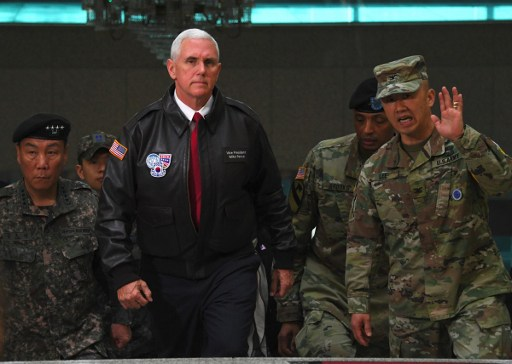 US Vice President Mike Pence (C) visits the truce village of Panmunjom in the Demilitarized Zone (DMZ) on the border between North and South Korea. Photo: AFP, Jung Yeon-Je