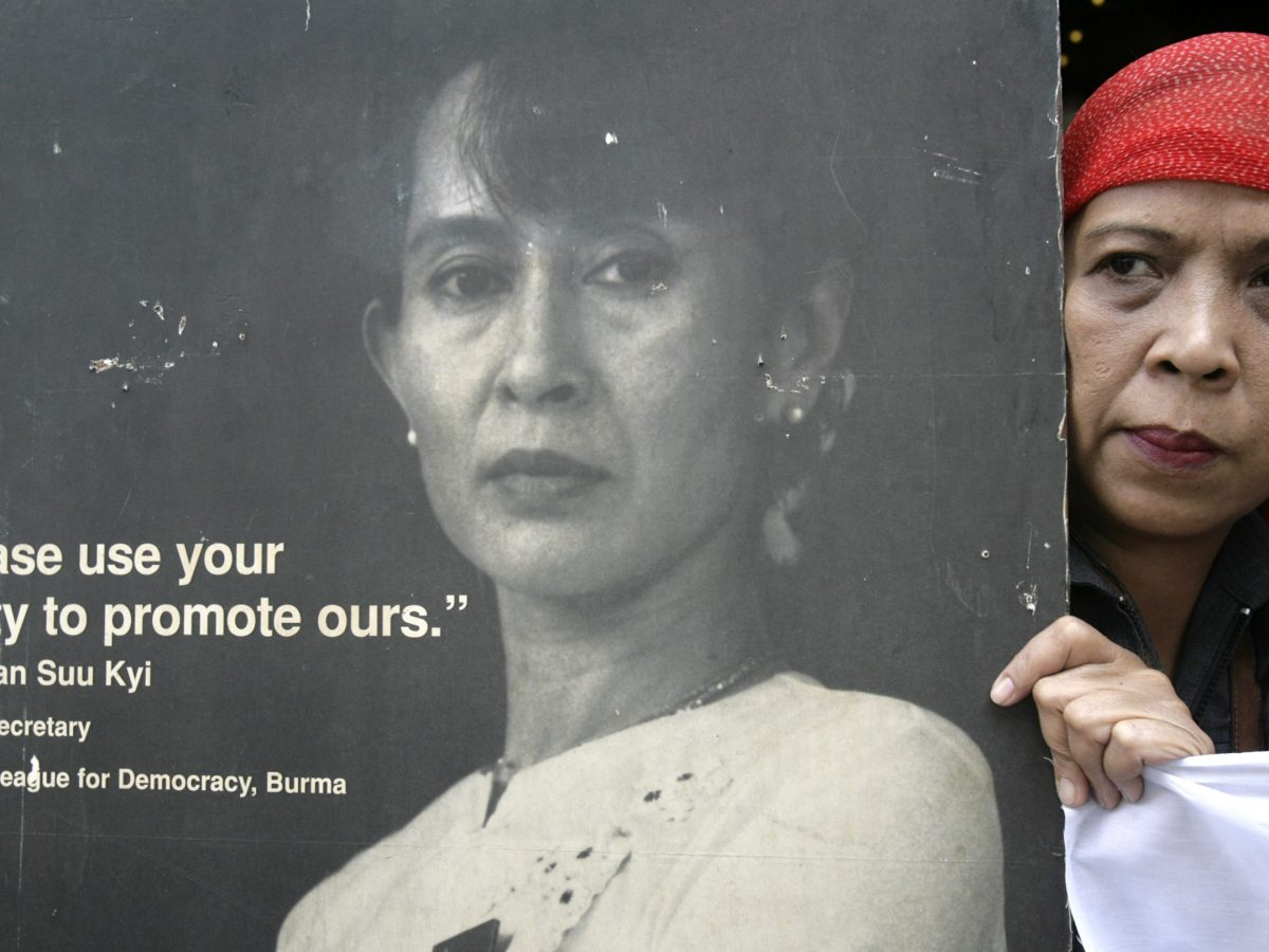 An activist holds a poster of then pro-democracy opposition leader Aung San Suu Kyi during a rally calling for peace and democracy in Myanmar, outside the building housing the Myanmar Embassy in Makati City, Manila September 26, 2007. Photo:  Reuters/Darren Whiteside