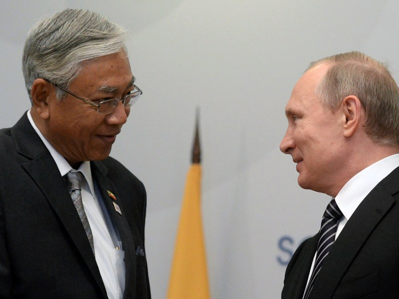 Russian President Vladimir Putin (R) greets Myanmar President Htin Kyaw during a meeting on the sidelines of the Russia-ASEAN summit in Sochi on May 19, 2016. / AFP PHOTO / Host Photo Agency / -