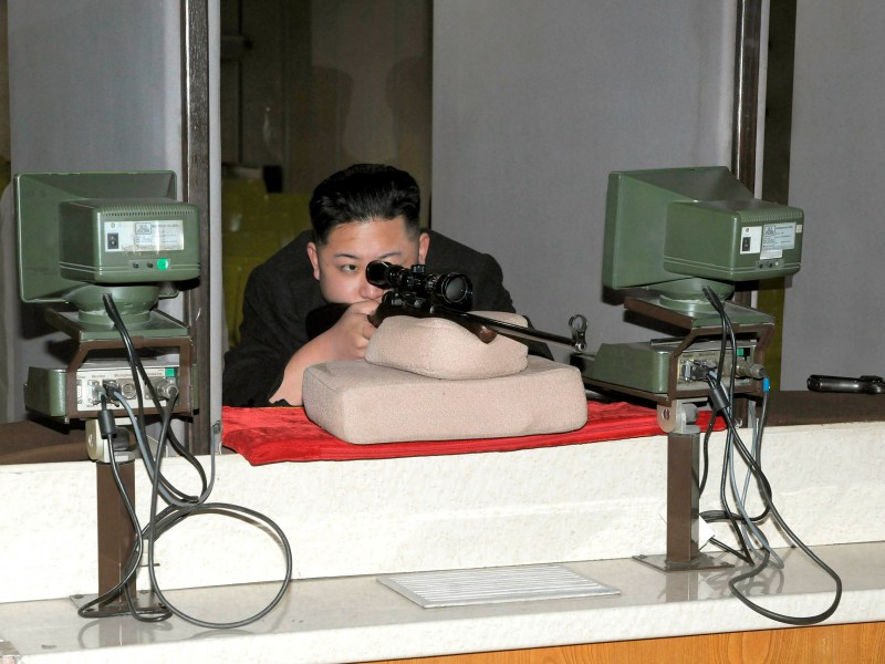North Korean leader Kim Jong-un aims a rifle at the Sporting Bullet Factory in Pyongyang. Photo: KCNA via Reuters