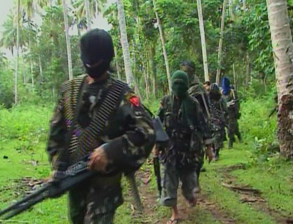 Abu Sayyaf rebels in the interior of the southern Philippine Jolo island in a file photo. Photo: Reuters/Philippine National Red Cross via Reuters TV
