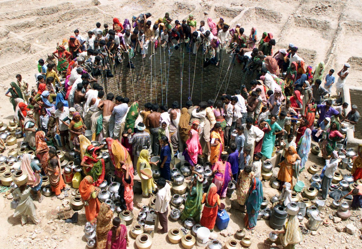 People gather to draw water from a well in the western Indian state of Gujarat. Photo: Reuters