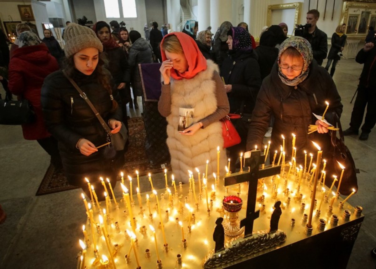 People including relatives of victims of the April 3 metro bombing in St Petersburg attend a memorial service at the city's Trinity Cathedral on April 5, 2017.  Photo: Reuters/Anton Vaganov