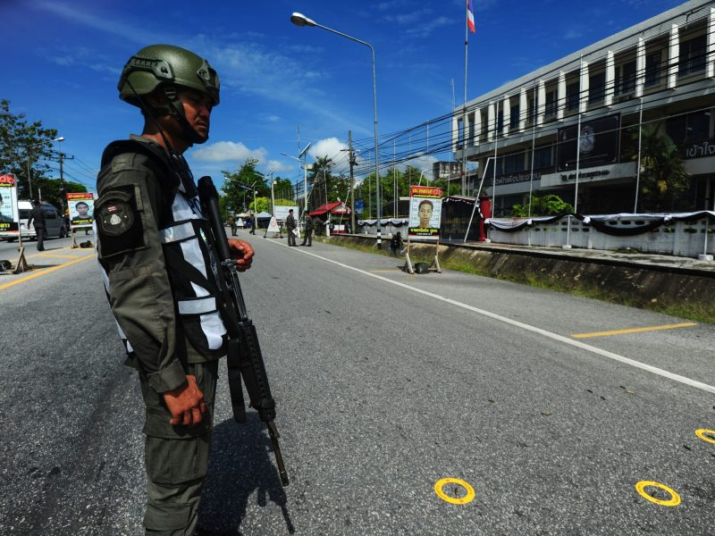 A Thai soldier stands watch over bullet markers at a crime scene in front of Rangae district police station, after a gun attack on the station by suspected militants which left one police officer dead and three others wounded, in the southern Thai province of Narathiwat on March 30, 2017. / AFP PHOTO / MADAREE TOHLALA