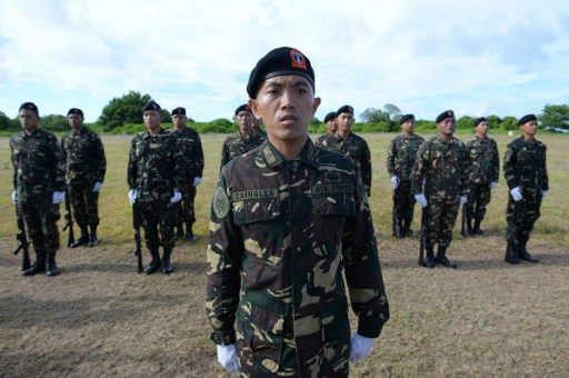 Philippine soldiers stationed at Thitu island. Photo: AFP/Ted Aljibe